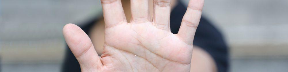 hand showing stop gesture